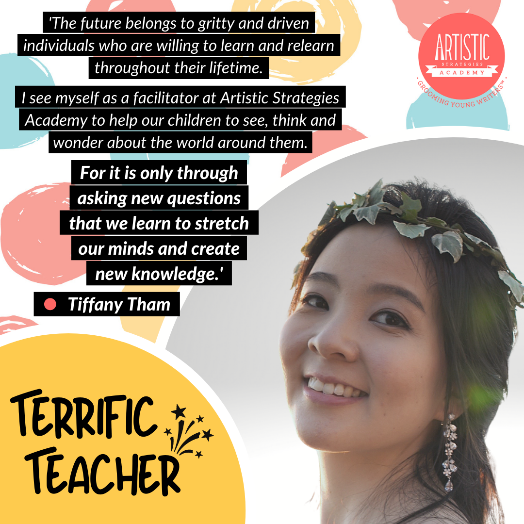 Quote: 'The future belongs to gritty and driven individuals who are willing to learn and relearn throughout their lifetime.  I see myself as a facilitator at Artistic Strategies Academy to help our children to see, think and wonder about the world around them. For it is only through asking new questions that we learn to stretch our minds and create new knowledge.' by teacher Tiffany Tham, who is turning her head to the left to face the camera, and wearing a crown of leaves and dangling pearl earrings. She has long hair and a bright smile on.